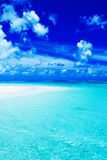 Empty beach with blue sky and vibrant ocean. Colors Stock Photography