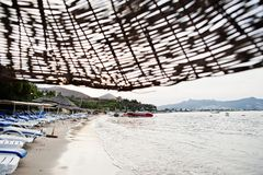Empty beach in Bodrum, Turkey. Blue sky, white sand, a dream holiday place to relax, snorkel and rest.  stock photo
