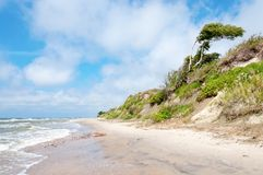 Empty beach. With brown sand and sea waves, Karkle, Klaipeda, Lithuania Royalty Free Stock Images
