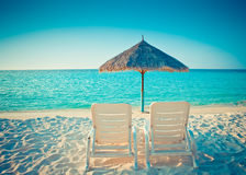 Empty beach chair before ocean, Stock Image
