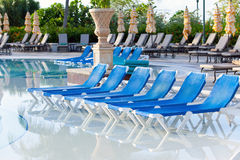 Empty beach chairs near pool Royalty Free Stock Photo