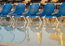 Empty beach chairs near  pool Stock Photos