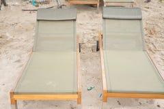 Empty beach chairs on sand Stock Photo