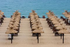 Empty beach with chairs and umbrellas Royalty Free Stock Image