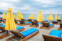 Empty beach chairs and umbrellas. Greece Stock Image