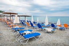 Empty beach chairs and umbrellas. Greece Stock Photos