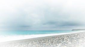 Empty beach at Chishingtan, Taiwan. Empty rocky beach at Chishingtan, Hualien, Taiwan on cloudy day Stock Images
