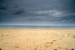 Empty beach and dramatic sky, Poland Stock Photo