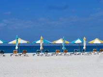 Empty beach. With loungers and closed parasols Stock Image