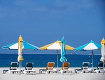 Empty beach. With loungers and closed parasols Royalty Free Stock Photography