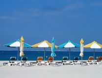 Empty beach. With loungers and closed parasols Stock Images
