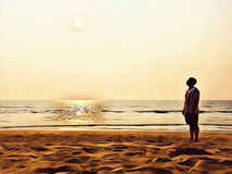 Empty beach with foot step marks. Lonely person staring at the sun. Stock Images