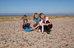 Empty beach and girls Stock Photos
