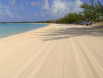 Empty beach in Half Moon Cay. Empty beach with flattened  sand, early in the morning. Little San Salvador Island, also known as Half Moon Cay, the archipelago of Stock Images