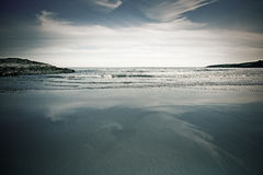 Empty beach in Ireland. Quiet, peaceful and empty  sandy beach in blue somewhere in Ireland Stock Photography