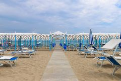 Empty beach, Italy, Riccione. Beach pathway to the canopy Stock Photo