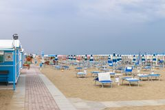 Empty beach, Italy, Riccione. Empty beach with sunbeds and umbrella Stock Image