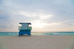 Empty beach with lifeguard cabin at sunrise. A lonely cabin on the empty beach Stock Photo