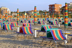 The empty beach with a lot of sunbeds and umbrellas. Stock Photography
