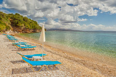Empty beach Lounge chairs under bright sunlight Royalty Free Stock Photo