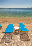 Empty beach Lounge chairs under bright sunlight Royalty Free Stock Photography