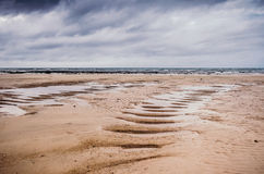 Empty beach in low tide Stock Photos
