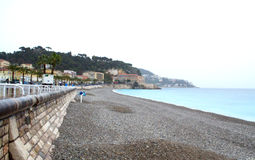 Empty beach,Nice French Riviera. Nice city coastline at French Riviera on rainy spring day.Cote d Azur,Mediterranean sea,France Royalty Free Stock Image