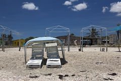Empty chairs on the beach. Empty beach at noon Stock Photos