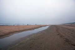 Empty beach of the North Sea in cloudy autumn weather Royalty Free Stock Images