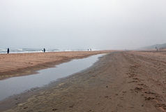 Empty beach of the North Sea in cloudy autumn weather Stock Photography