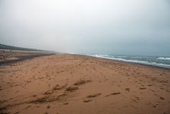 Empty beach of the North Sea in cloudy autumn weather Royalty Free Stock Photos
