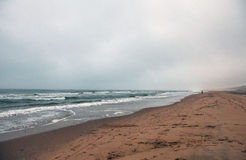 Empty beach of the North Sea in cloudy autumn weather Royalty Free Stock Image