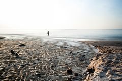 Empty beach at Baltic Sea long exposure or fisherman Stock Images