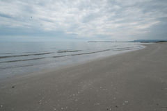 Empty beach on an overcast day. Royalty Free Stock Photos