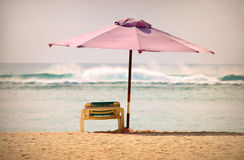Empty beach with parasol. Stock Images