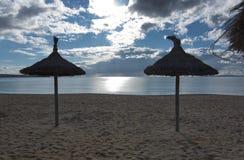 Empty beach with parasols. In Palma de Mallorca on a sunny day in November in Mallorca, Balearic islands, Spain Royalty Free Stock Photo