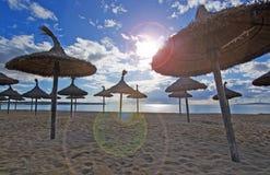 Empty beach with parasols. In Palma de Mallorca on a sunny day in November in Mallorca, Balearic islands, Spain Stock Image