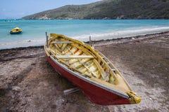 Empty boat on a beach stock photos