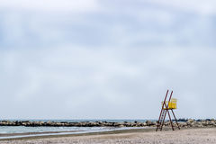 Empty beach. Red and yellow lifeguard post on empty sandy beach Royalty Free Stock Photos