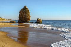 Empty beach with ruined stone defense tower. Beach and old ruined defense tower royalty free stock photos