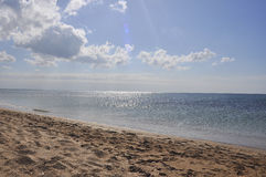 Empty beach and seaview. View of empty calm sea and a piece of empty beach Stock Photography