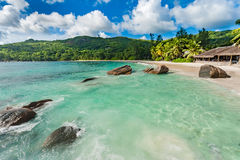 Empty Beach in Seychelles, Mahe island. Rocks and Palm trees in background. Indian Ocean. Stock Photos