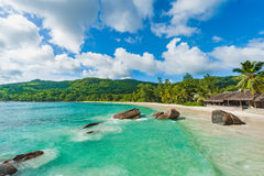 Empty Beach in Seychelles, Mahe island. Rocks and Palm trees in background. Indian Ocean. Stock Image