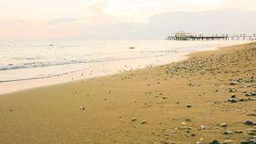 Empty beach and soft waves at early evening stock video footage