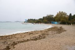 Empty beach during south wind in off season. Vodice, Croatia - October, 28, 2018: Empty beach during south wind in off season royalty free stock photos