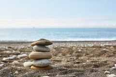 Empty beach with a stack of rocks royalty free stock images