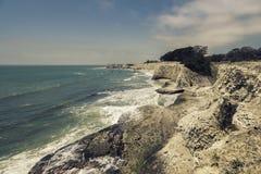 Empty Beach with steep cliffs Stock Photos
