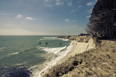 Empty Beach with steep cliffs Stock Image