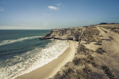 Empty Beach with steep cliffs Stock Photography