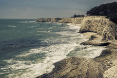 Empty Beach with steep cliffs Royalty Free Stock Images